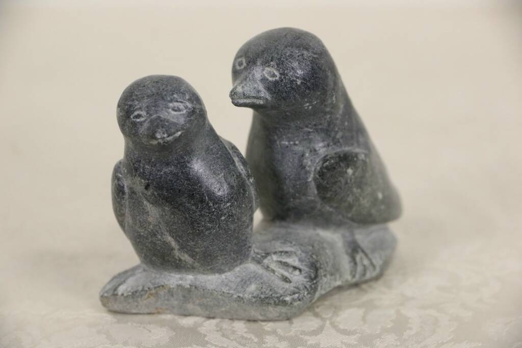 Sold inuit hand carved soapstone sculpture pair of
