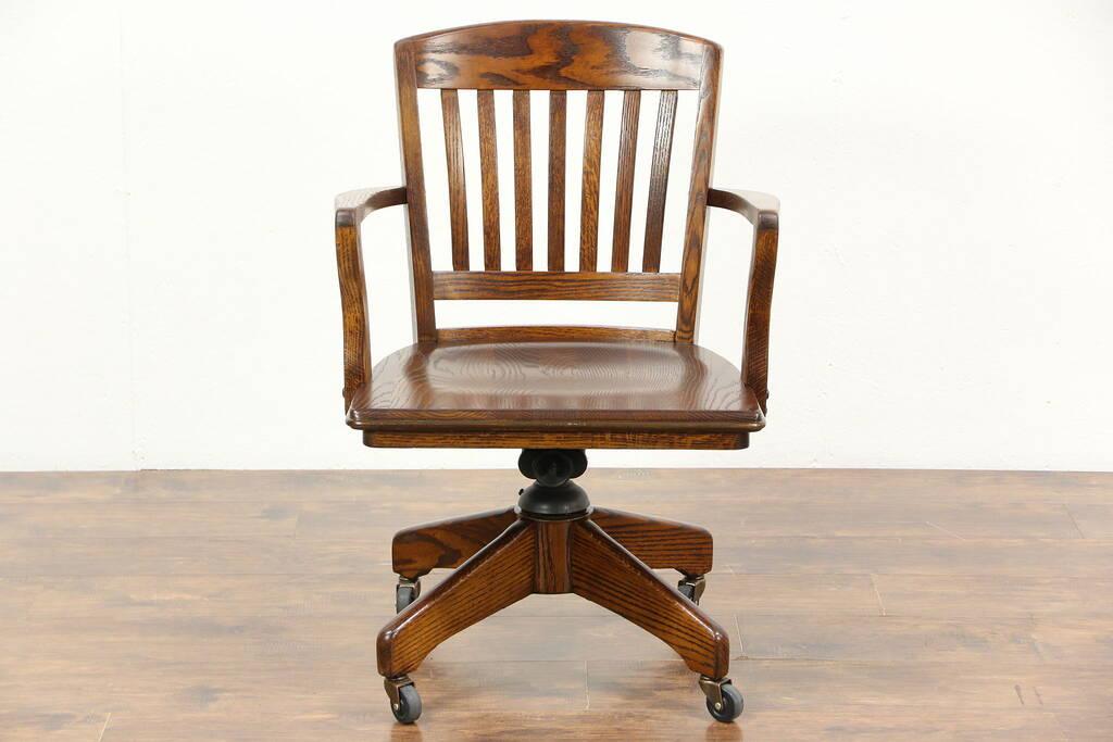 Sold oak vintage swivel adjustable desk chair arms