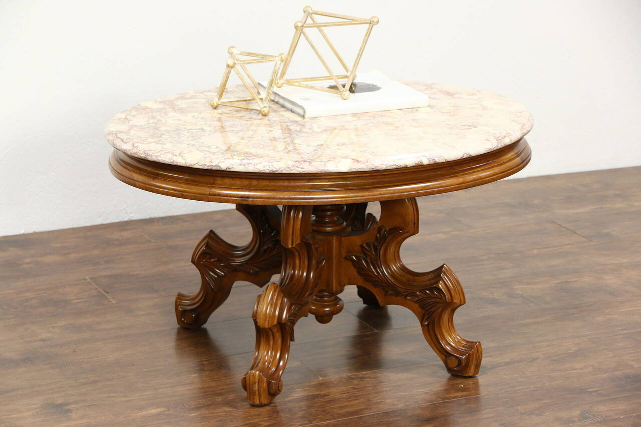 Victorian style vintage carved walnut oval coffee table for Antique victorian marble top coffee table