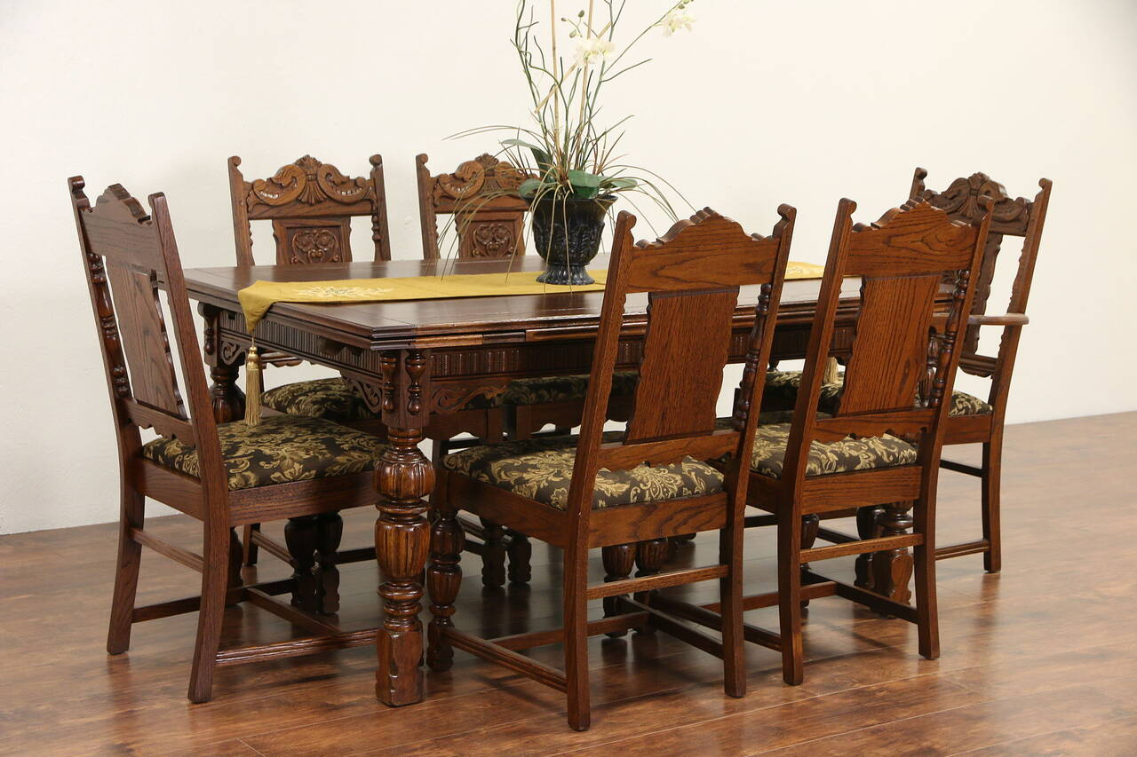 English tudor 1920 antique carved oak dining set table for Antique dining room furniture