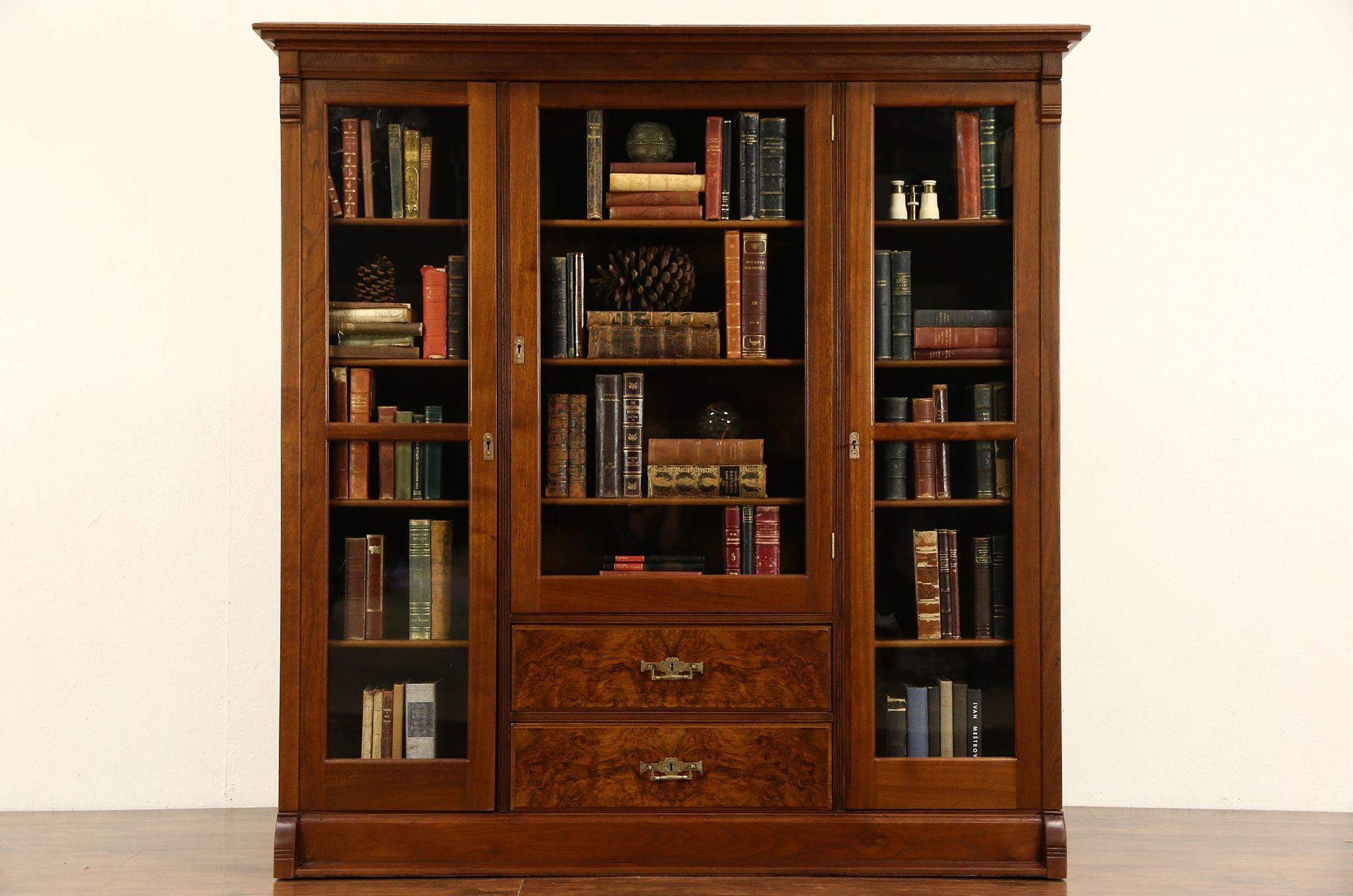 Victorian Eastlake 1885 Antique Walnut Triple Library Bookcase Wavy Glass Doors