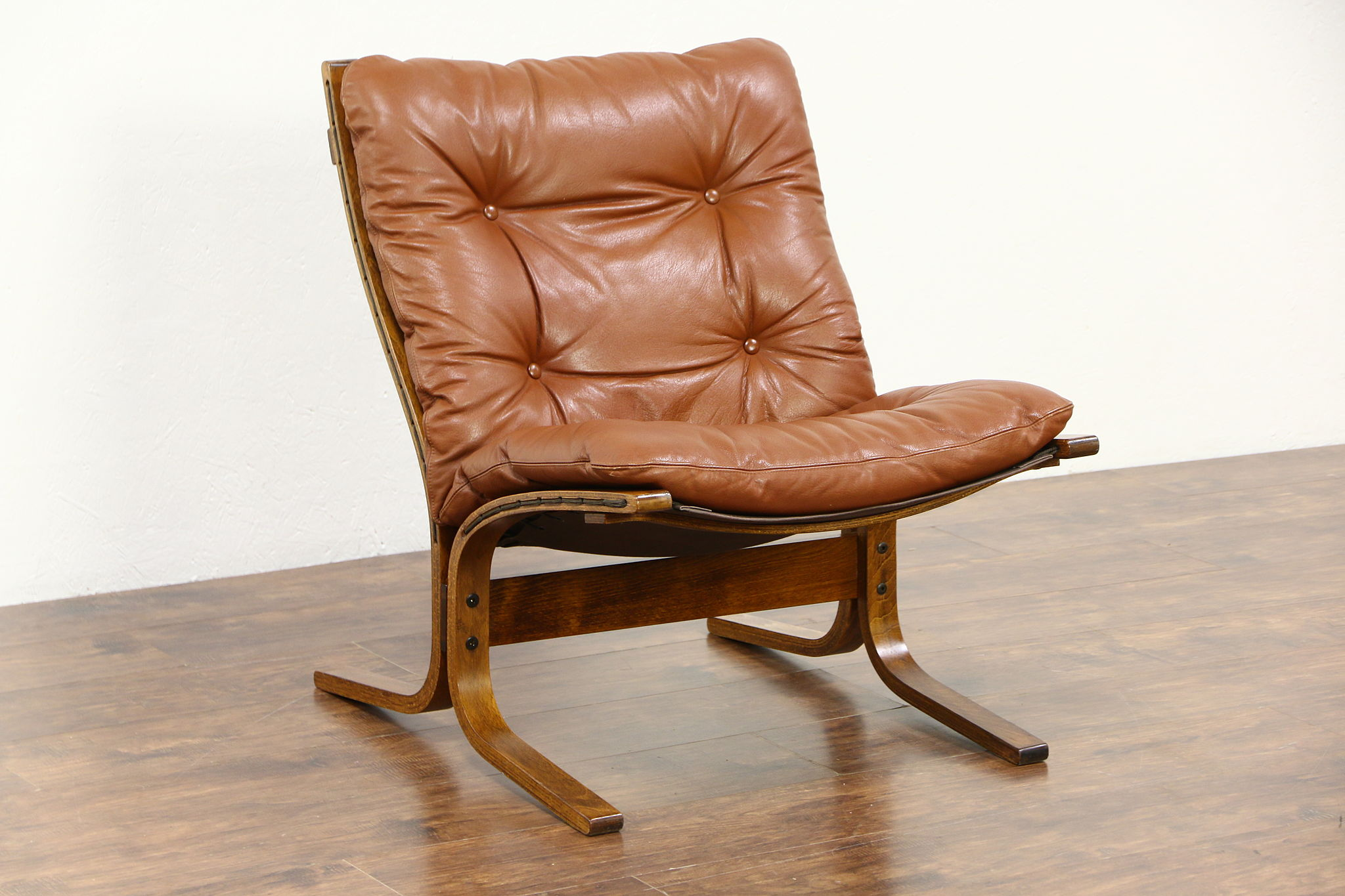 Midcentury modern 1960 vintage tufted leather chair made in norway