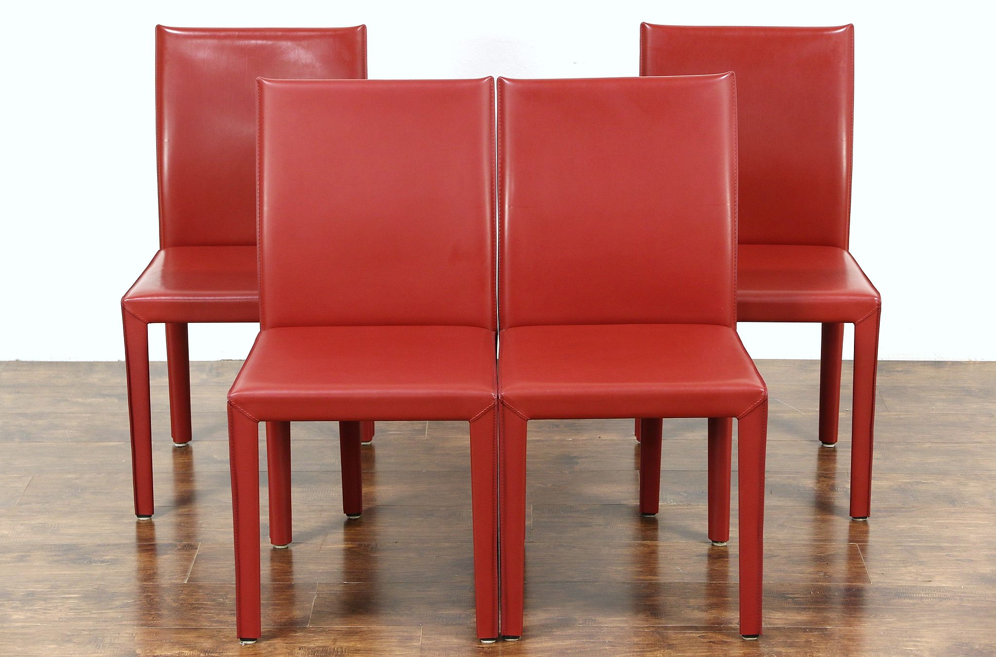 Set of 4 red leather dining or game table chairs signed maria yee ca