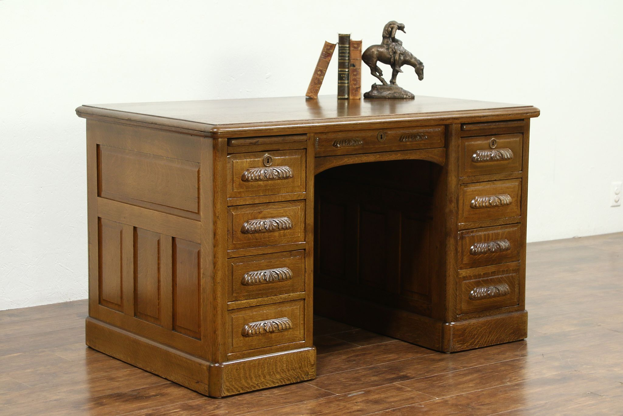 sold - oak raised panel 1900 antique library or office desk, carved