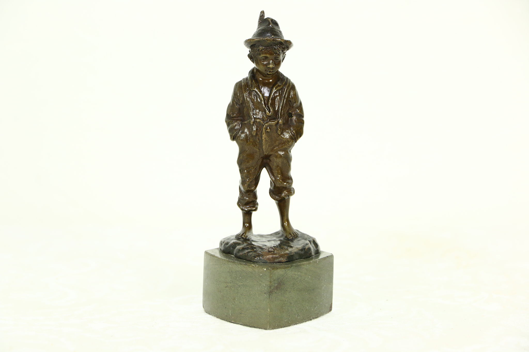 Bronze Antique Sculpture Of A Boy With A Feather In His