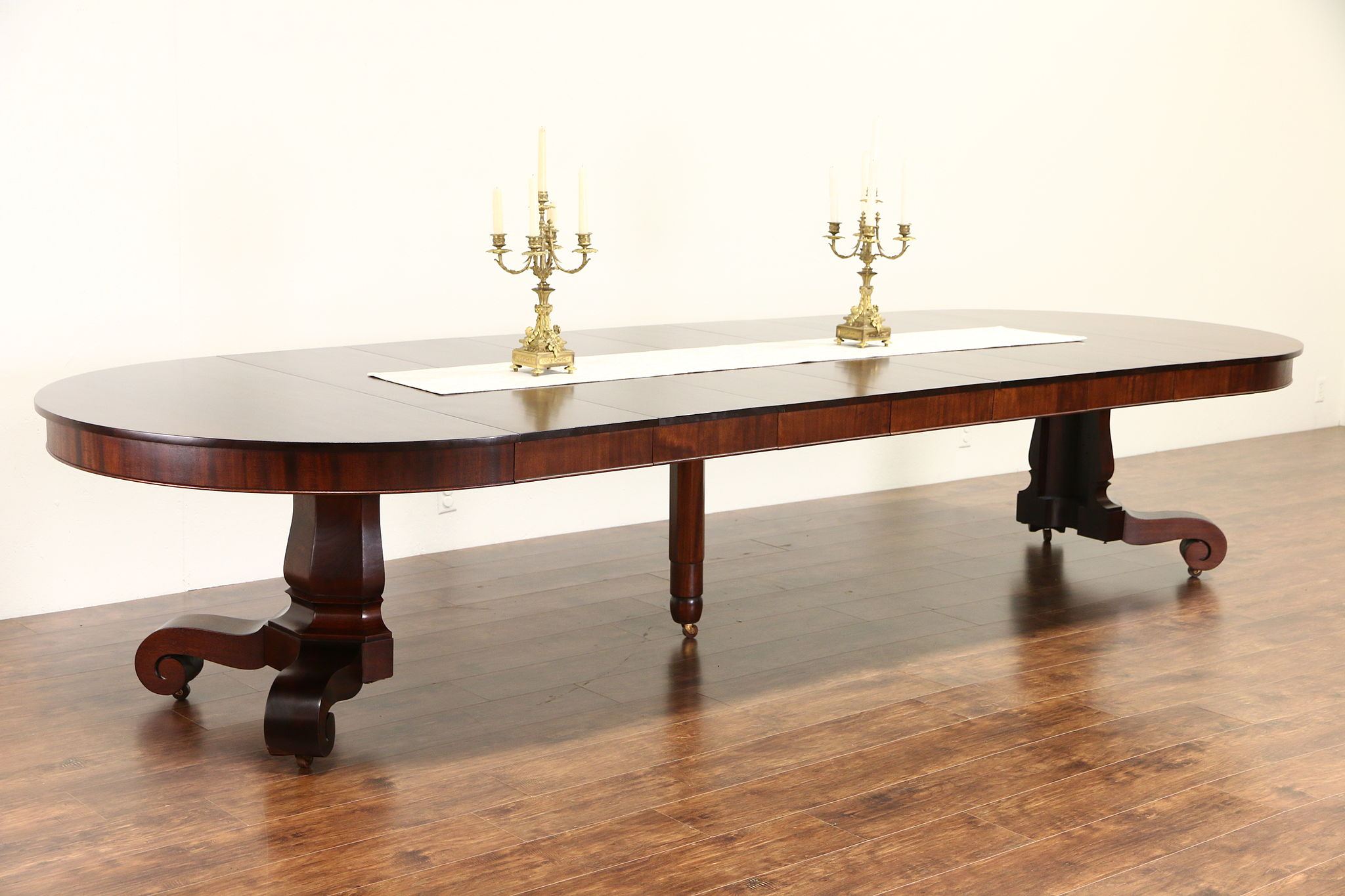 Empire mahogany 1910 antique 54 round dining table 7 leaves extends 13