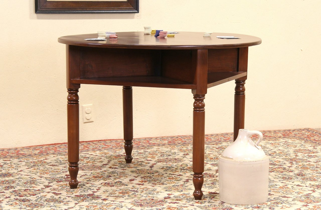 Round 1890s antique tavern or pub game or card table drink shelves